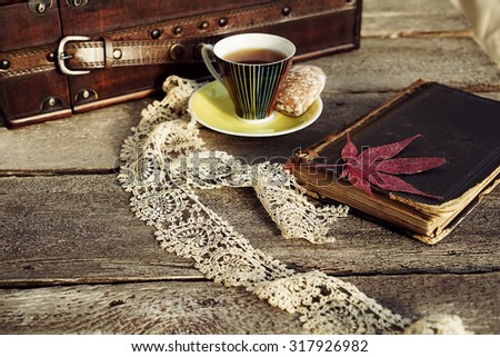 Vintage composition of retro style and tea cup - stock photo