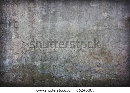 vintage concrete cracked wall with artistic shadows added - stock photo