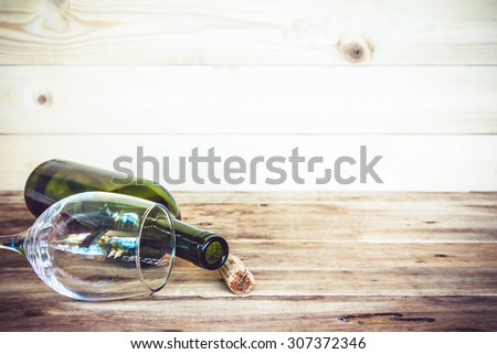 vintage cork from wine bottle and glass on the old wood floor. - stock photo