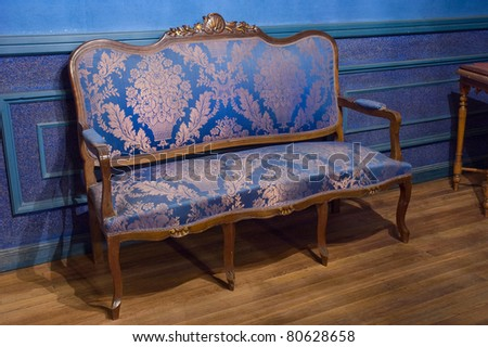 vintage couch on wooden floor - stock photo