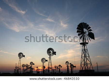 Vintage Country Windmills at Sunset - stock photo