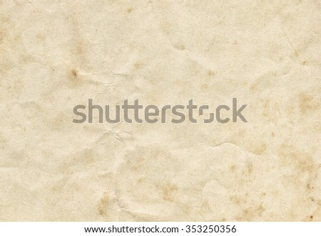 Vintage crumpled paper background with old spots. Old paper texture for design. - stock photo