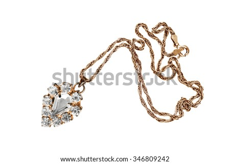Vintage crystal pendant on golden chain isolated over white - stock photo