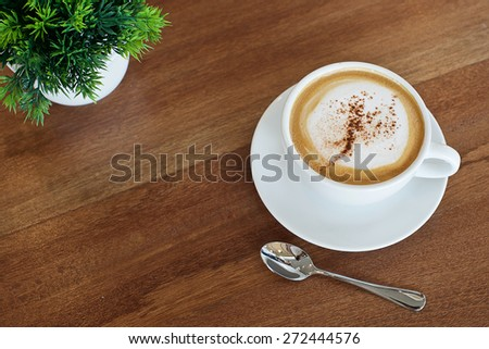 Vintage Cup Of Coffee Latte - stock photo