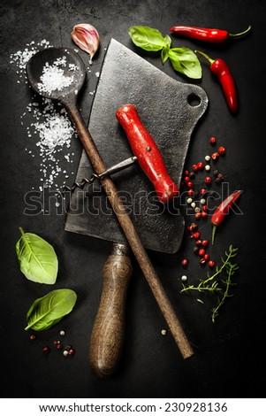 Vintage cutlery and fresh ingredients on dark background - stock photo