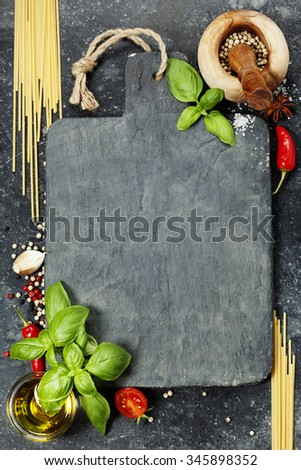 vintage cutting board and fresh ingredients - Cooking, Healthy Eating or Vegetarian concept - stock photo