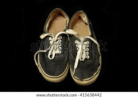 vintage dark blue shoes on black background