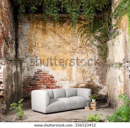 vintage decor modern sofa ruined wall - stock photo