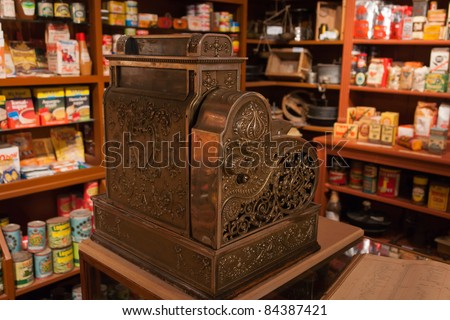 Vintage decorated metal cash register in an old  general store - stock photo