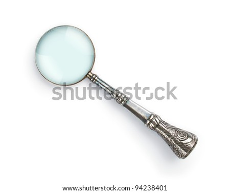 Vintage decorative magnifying glass isolated on white background - stock photo