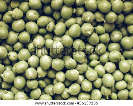 Vintage desaturated Green peas useful as a food background - stock photo
