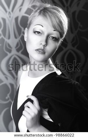 Vintage desaturated portrait of a blond woman