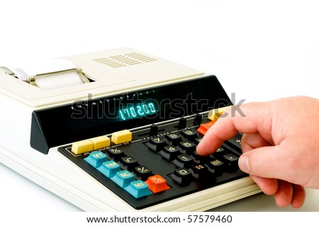 Vintage desctop calculator in front of a white background - stock photo