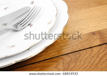 Vintage dishes and cutlery set - stock photo