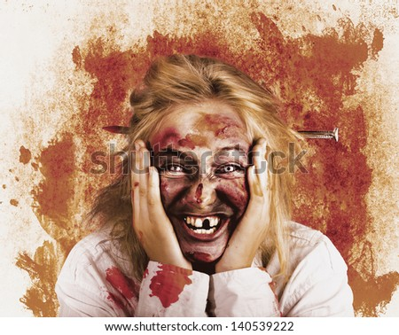 Vintage distressed portrait of a chilling female witch laughing with a wicked stare. Grunge horror concept - stock photo