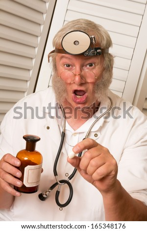 Vintage doctor telling the patient to open his mouth for a big pill - stock photo