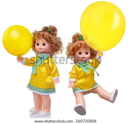 Vintage doll in yellow dress with balloon set isolated on white - stock photo