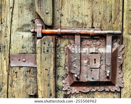 Rustic vintage doorknob on antique door stock photo for Door lock germany