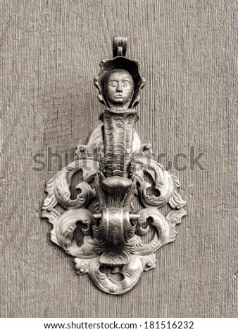 Vintage doorknob on antique door, background. Impressive knob with a womans figure from the medieval city of Bamberg in Bavaria, Germany / Europe, Unesco world culture heritage - stock photo