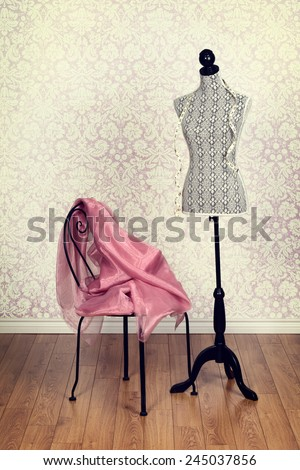 vintage dress form pink fabric - stock photo