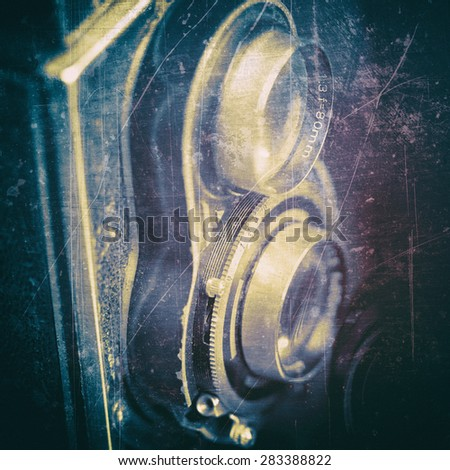 Vintage dual lens camera on a black background - stock photo
