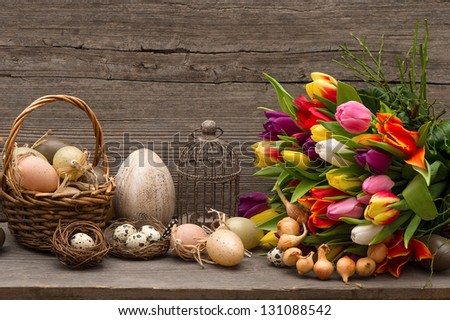 vintage easter decoration with eggs and tulip flowers. nostalgic still life home interior - stock photo