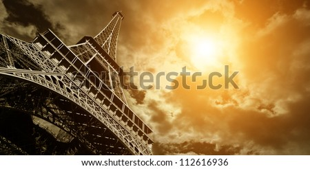 Vintage Eiffel Tower wit a Dramatic Sunset - stock photo
