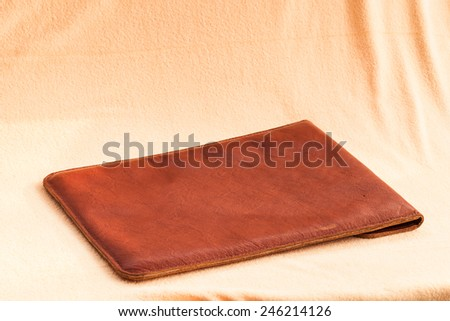 Vintage elegant brown leather briefcase for laptop computer. - stock photo