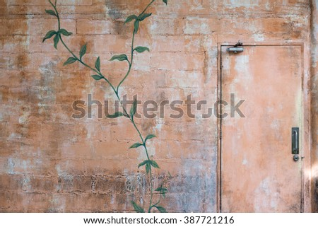 vintage emergency exit on brick wall with color paint - stock photo