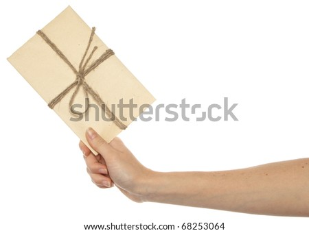 Vintage envelope in woman's hand - stock photo