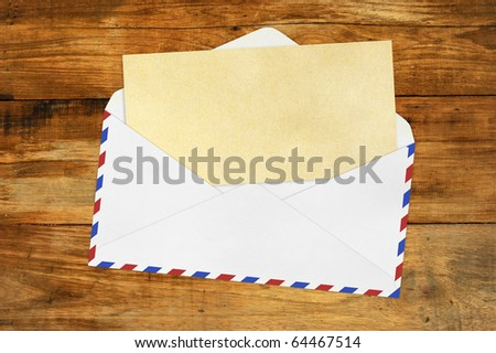 Vintage Envelope with blank Brown  paper on wood . - stock photo