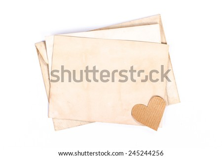 vintage envelope with yellow paper heart - stock photo