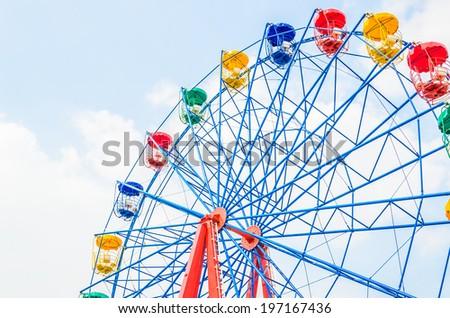 Vintage ferris wheel in the park - stock photo