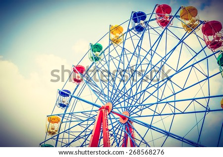 Vintage ferris wheel in the park  - vintage effect style pictures - stock photo