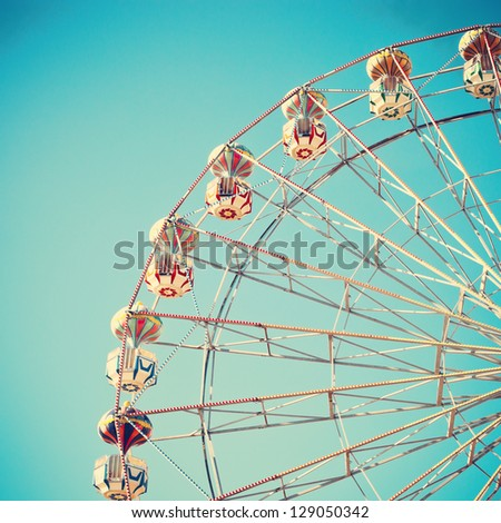 Vintage Ferris Wheel Over Turquoise Sky - stock photo