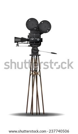 Vintage Film camera. A Turn of the century vintage old film movie camera with wooden tripod. - stock photo