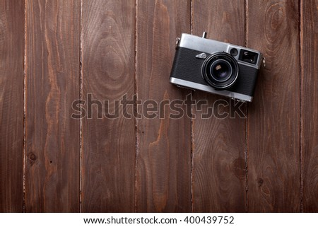 Vintage film camera on wooden table. Top view with copy space - stock photo