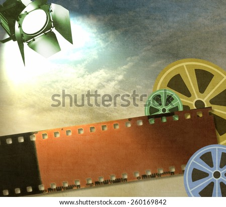 Vintage film strip background with reels and reflector - stock photo