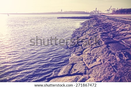 Vintage filtered an old port embankment made of stones in Swinoujscie, Poland.