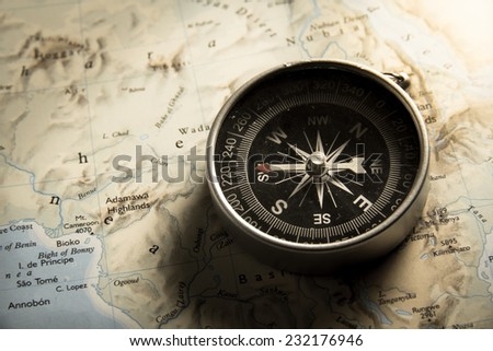 Vintage filtered of compass with map. - stock photo