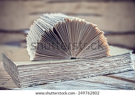 Vintage filtered picture of an open book, concept background. - stock photo
