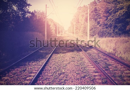 Vintage filtered picture of railroad tracks. - stock photo