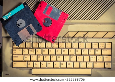 Vintage floppy disks and keyboard - stock photo