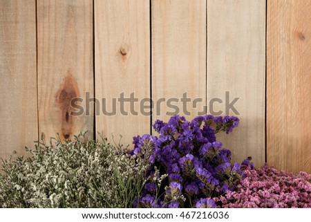 Vintage flower on wooden background with space for text