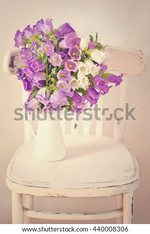 vintage flowers background with campanula bouquet. - stock photo