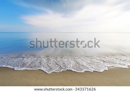 vintage, foamy wave on  beach - stock photo