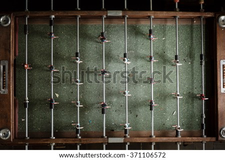 Vintage foosball table game. view from top. Color toned image. - stock photo