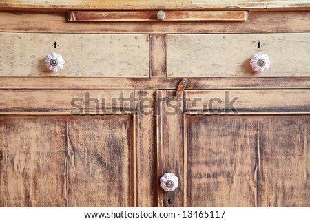 vintage, fragment of the old-time closet after restoration, doors and boxes - stock photo