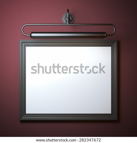 Vintage frame with lamp on red wall - stock photo