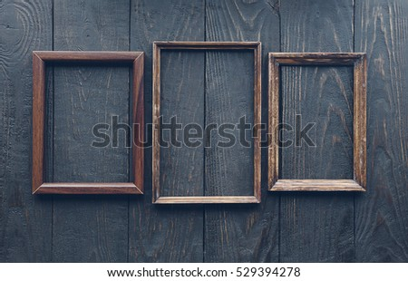 Vintage Frames On Old Wooden Wall Stock Photo (Royalty Free ...
